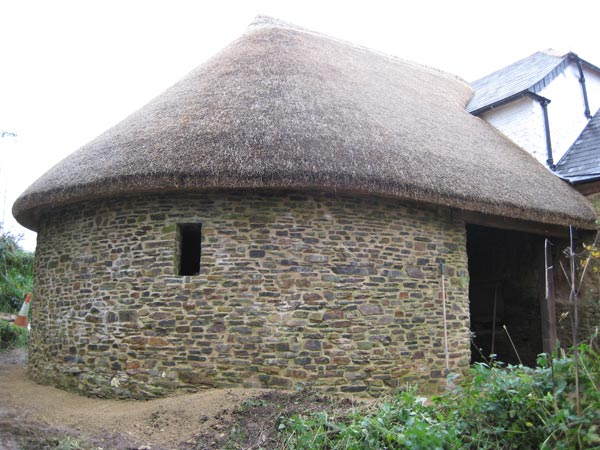 The restored roundhouse complete with thatched roof at South Yeo Farm West